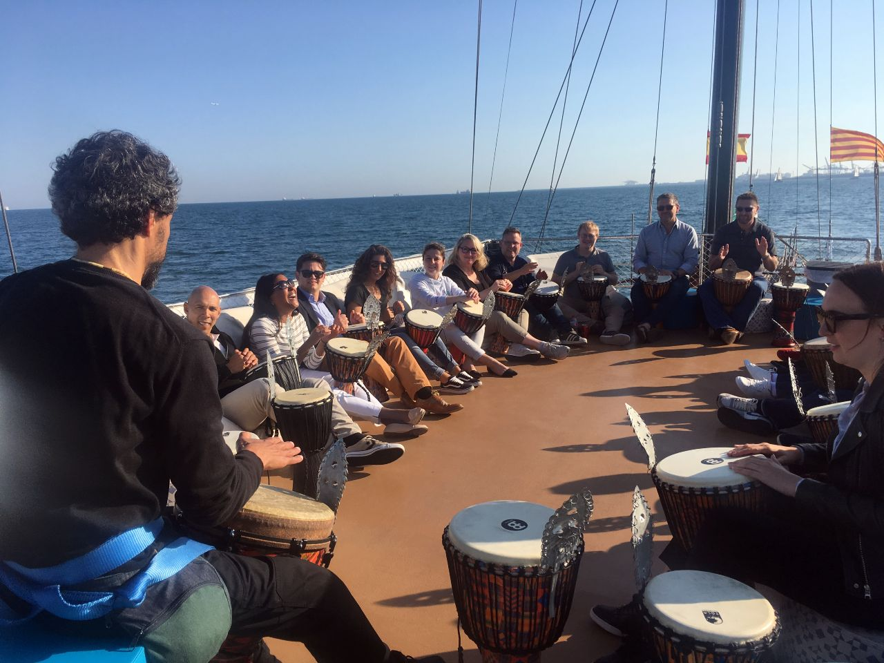 Music team building activity on boat